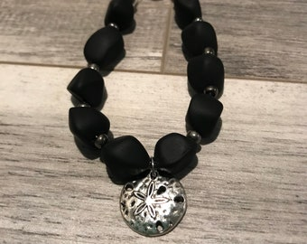 Black Sea glass beads with sand dollar charm