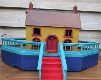 Early 20th century painted wooden Noah's ark on wheels with 17 wooden animals push along toy