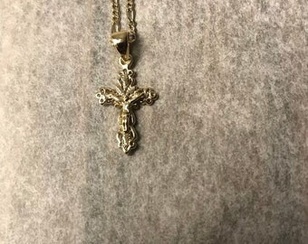 Gold necklace and cross pendant.