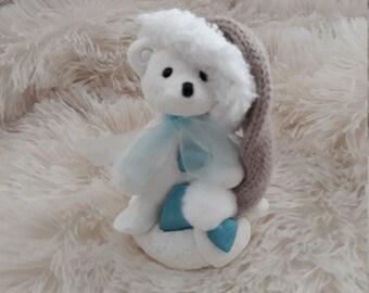 White bear, brown hat