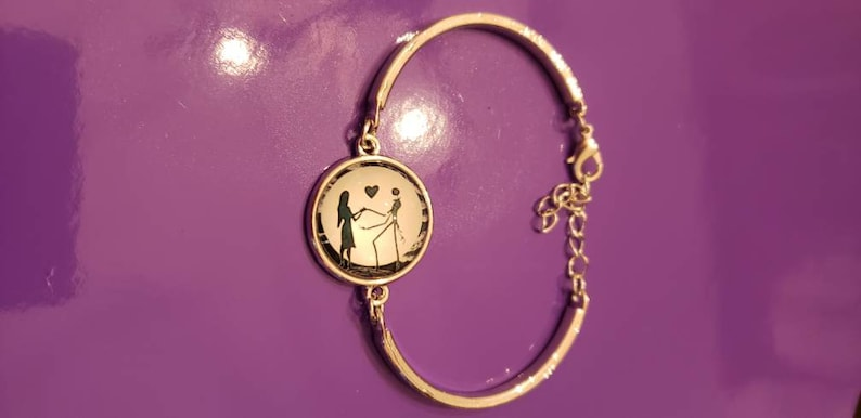Disney Nightmare Before Christmas inspired silver bracelet with Jack and Sally glass cabochon