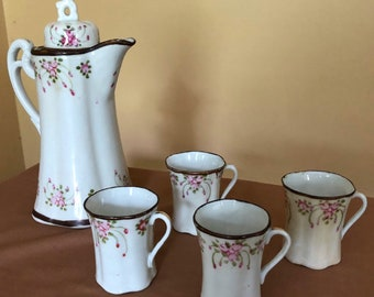 Vintage porcelain hand painted coffee pot with four demitasse cups
