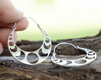 Round earrings with silver-colored moons