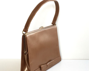 Gorgeous vintage 50s leather handbag, vintage purse, with bow detail in bronze pearlised leather by Waldybag