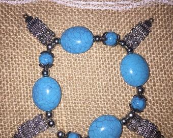 Turquoise beaded owl bracelet