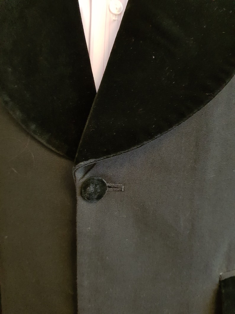 Smart and showy mens tuxedo dinner  jacket with velvet lapels and purple lining