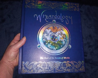 Wizardology: The Book of the Secrets of Merlin (Ologies) by Master Merlin-Preowned, good shape. Ask to bundle books for overage refund