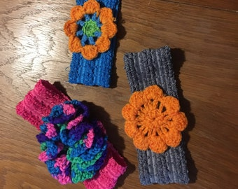 Hand made crochet flowers attached to an elastic headband for infant or toddler