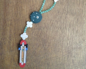 Rosary in green, mother of Pearl stone and leather inlay