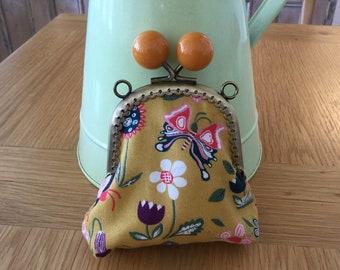 Cute handmade coin purse. Mustard floral fabric.