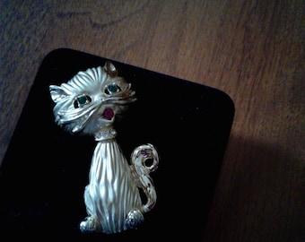 B.S. K Cat brooch with green eyes