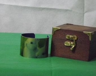 A handmade velvet lined cuff bracelet with accompanying oiled wooden box which is also lined.