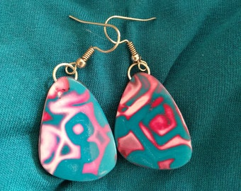 pink and blue earrings from the Masha collection. Model 1