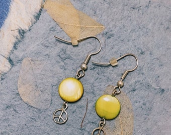 Silver and Green Dangle Earrings with Peace Signs