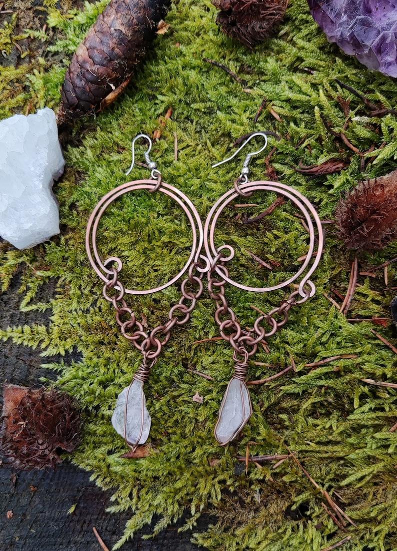 Long clear quartz priestess earhangers; copper birthstone earrings
