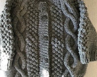 Hand knitted 8 ply acrylic cabled cardigan.