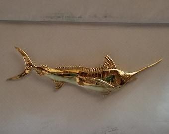 Gold Marlin pendant by Van Mark