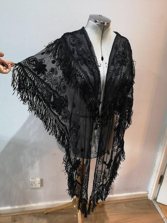 An antique black fringed shawl, fringed black shaw