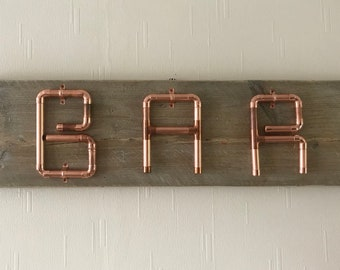 Reclaimed Copper pipe bar sign