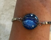 blue ocean round adjustable bracelet, stainless steel with acrylic under glass, stylish light everyday unique artisan jewelry