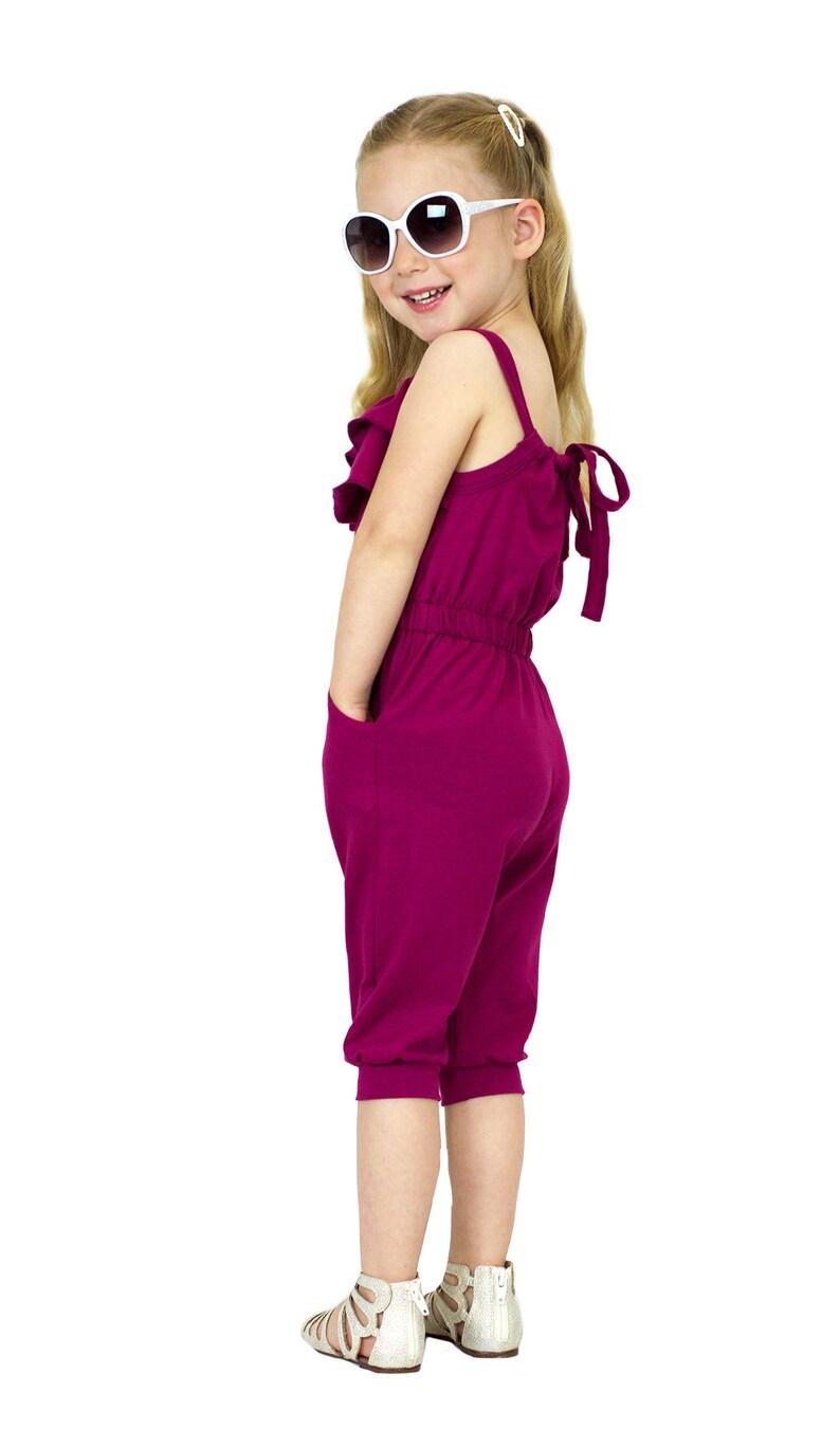 b23ea0d317a Girls Back Tie Adjustable Flouncy Magenta Jumpsuit with