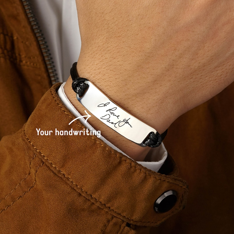 """The warmth of the father's hands always brings the feeling of safety and trust to us. So, this father's day why not bring this feeling to him with a Men's Handwriting Bracelet? Engraved with the actual handwriting on the front and custom message on the back (""""happy fathers day dad"""" for example), this leather bracelet will be a good fathers day gift for your dad. Every time he wears it, he will surely feel like you are by his side."""