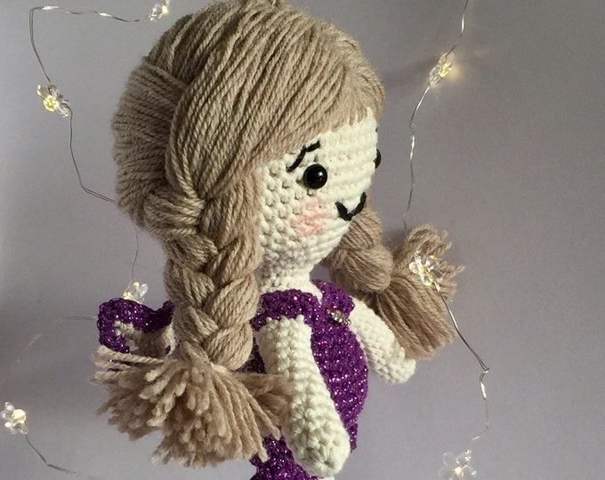 Christmas Angel with sparkling purple dress.