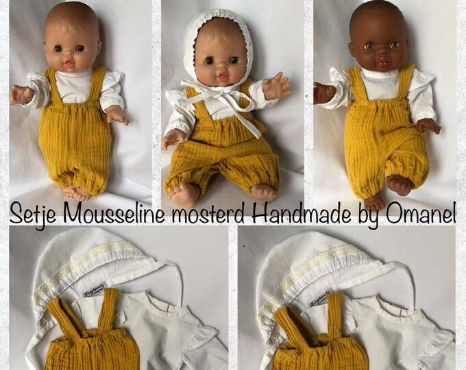 Set of cute doll clothes, consisting of a puff pants with shoulder straps, blouse with ruffles on the sleeves and a hat.