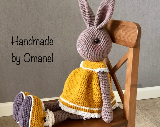 Sweet Rabbit with standing ears complete with curry-colored crochet dress and matching shoes