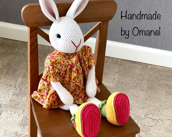 Sweet rabbit with standing ears complete with cute dress and matching shoes.