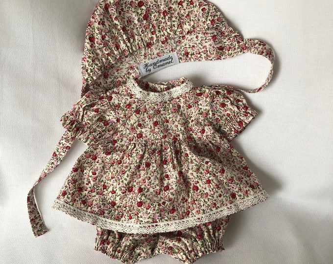 Set of dolls clothes. Dress with lace, trousers and bonnet.