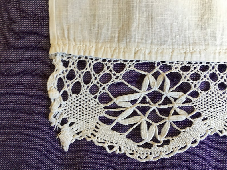family growth and well being symbols small valance with crocheted ending Vintage white cotton embroidered floral curtain panel