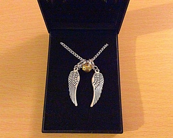 Angel wings golden snitch necklace