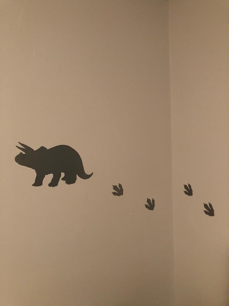 Dinosaur and footprint wall decals