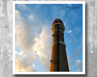 Photography of Lighthouse on Cabo Polônio cost Uruguay south America, against cloud sky at susnet light.