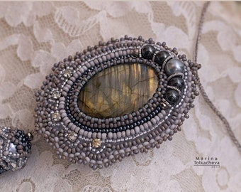 Sun through the clouds. pendant with a brush, labradorite and beads
