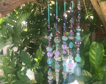Driftwood suncatcher with agate and amethyst crystals and beads and baubles