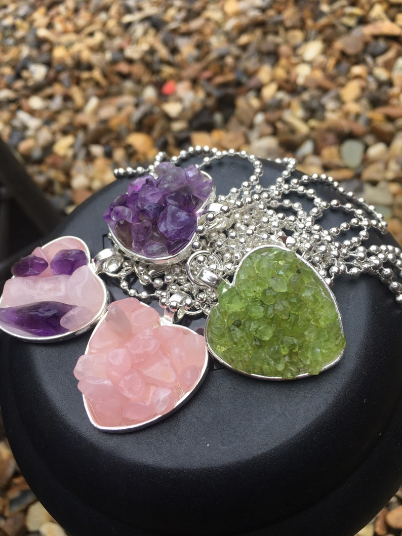4 options available. Natural Crystal Filled Heart Silver Alloy Amulet with Silver plated Necklace Handmade
