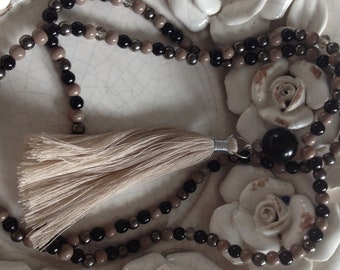 long necklace with beige tassel