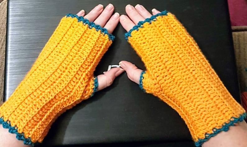 orange fingerless mittens with emerald trim image 0