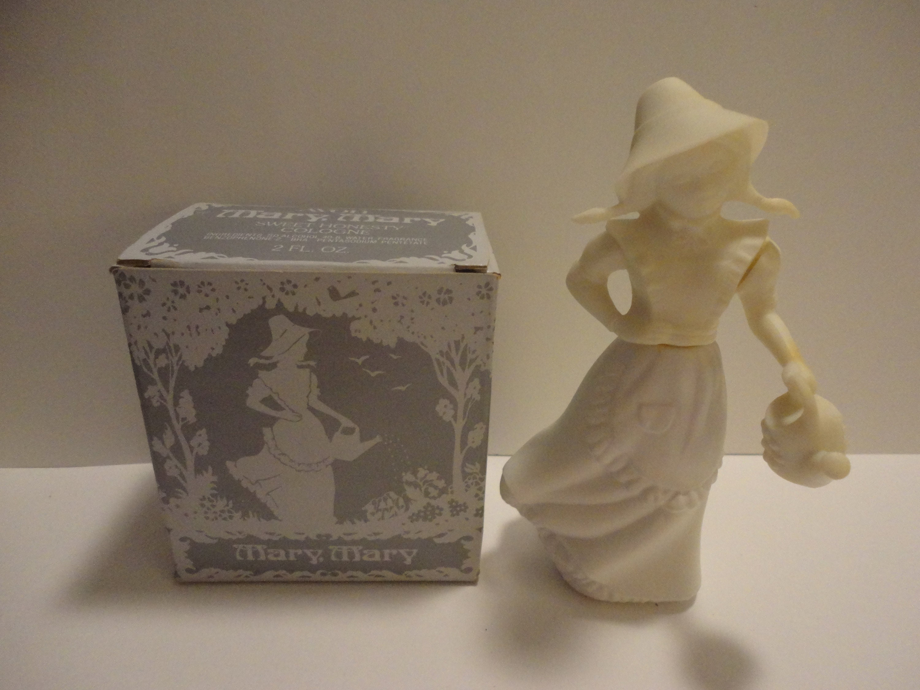 Avon Mary Mary perfume bottle and sweet