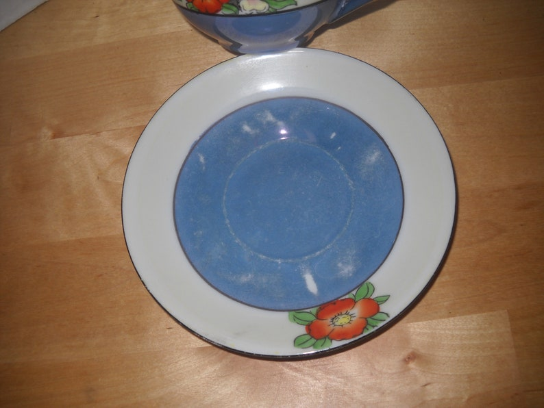 Made in Japan cup and saucer blue white red yellow flower pansy cup 2 18 tall saucer 5 12 diameter gold trim 1950s lustre