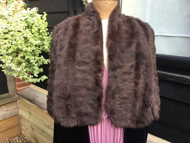 Vintage fur cape with arm slits 1950s from Brahams Norwich horizontal seaming