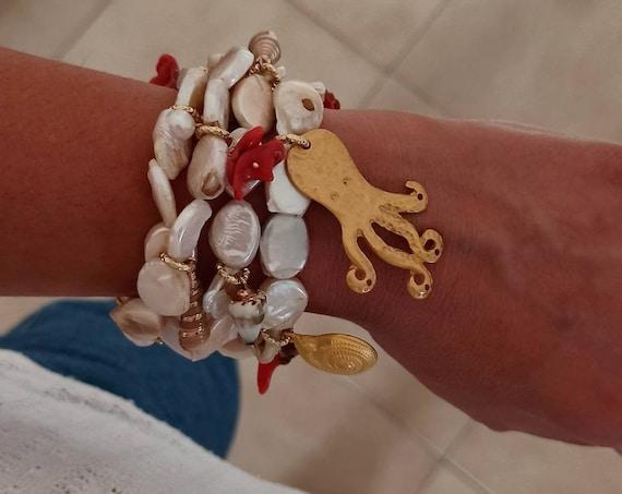 Multi strand pearl bracelet with Brass Pendants
