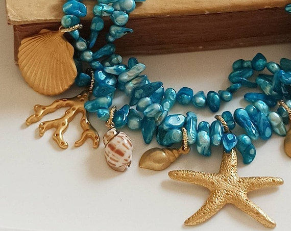 Multi strand beaded necklace with blue Pearls and Brass Pendants