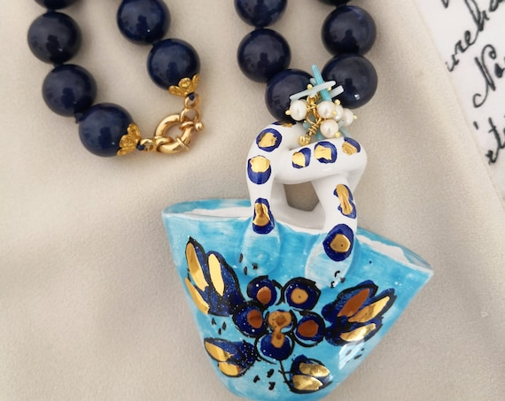 Handknotted necklace with blue stones and Sicily ceramic handbag