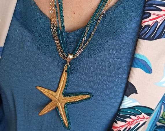 Multi strand necklace with starfish pendant