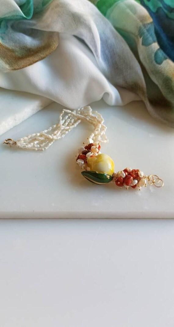 Multi strand bracelet with little Pearls and Sicily Ceramic Lemon