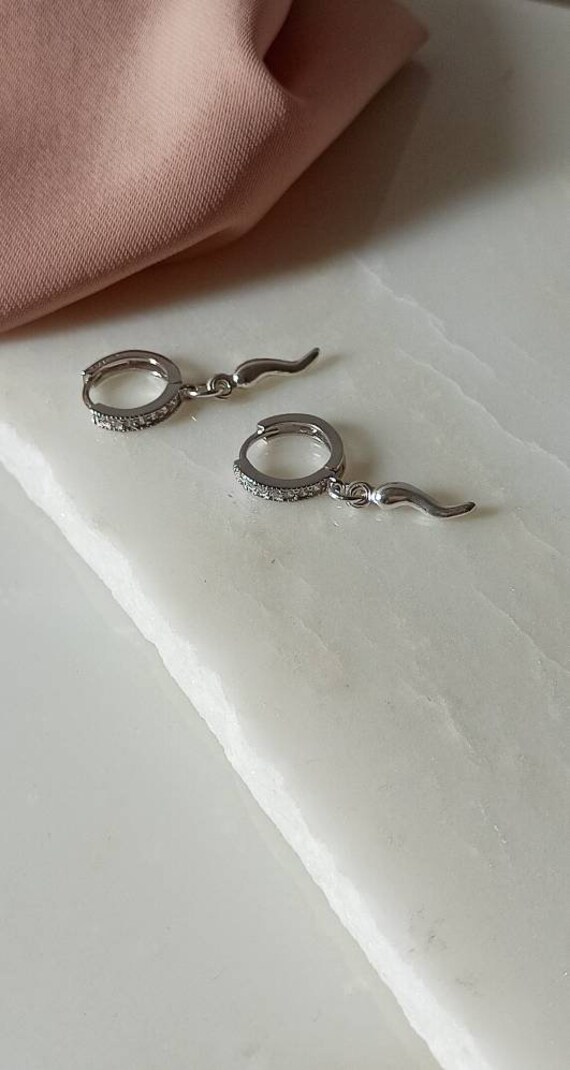 Tiny hoops with horn charms