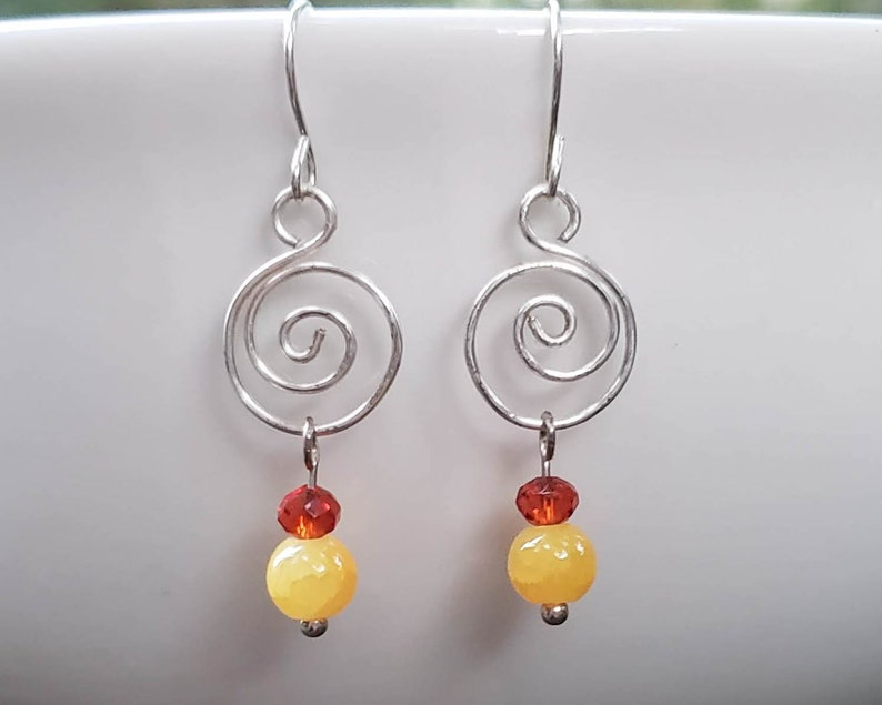 Silver Spiral with Orange and Yellow Glass Bead Earrings image 0